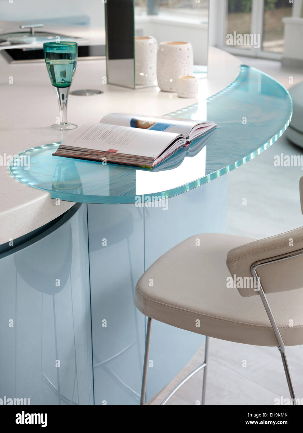 Detail Of Blue And White Curved Glass Inset Breakfast Bar
