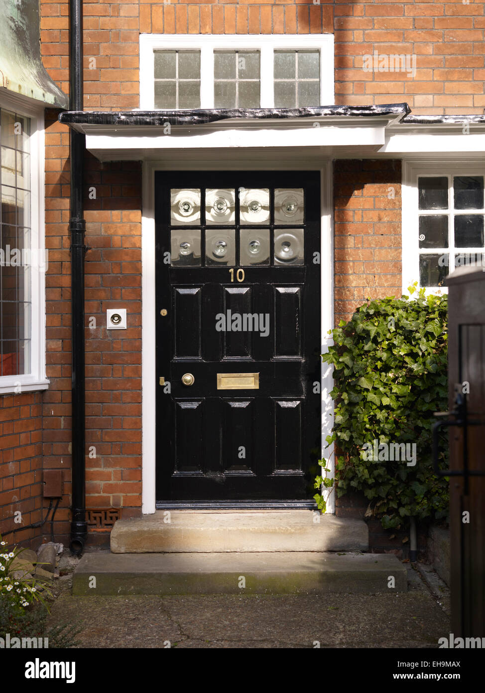 Traditional Black Front Door Of Redbrick House Kingsmead Uk Stock