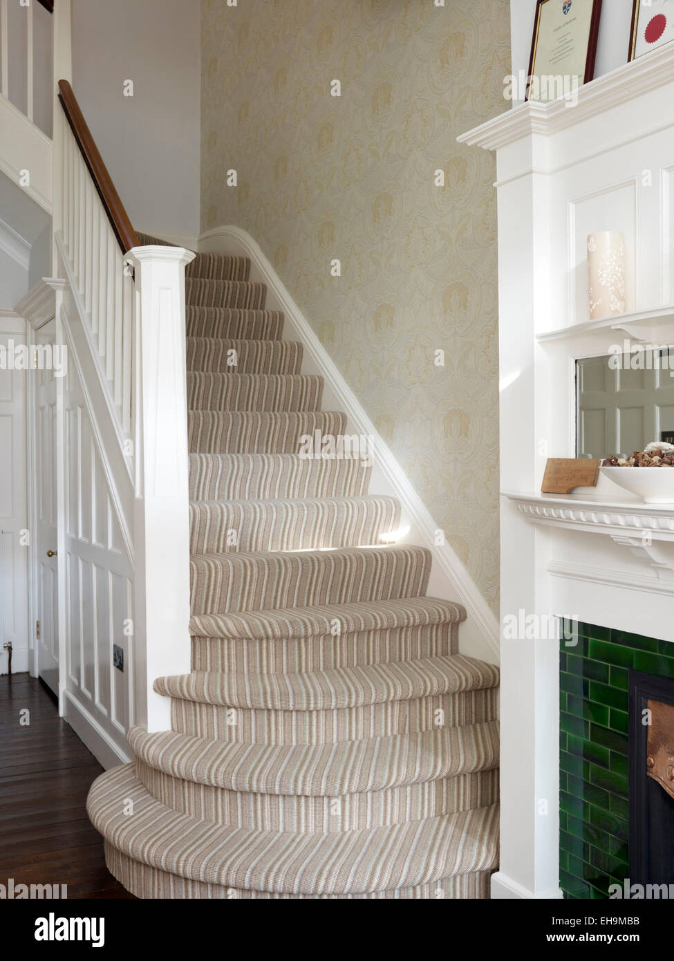 Staircase leading up from entrance hall, residential house, Kingsmead, UK - Stock Image