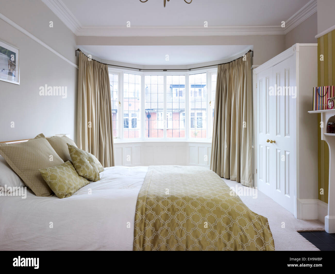 Spacious Bedroom With Double Bed And Bay Windows Residential House Stock Photo Alamy