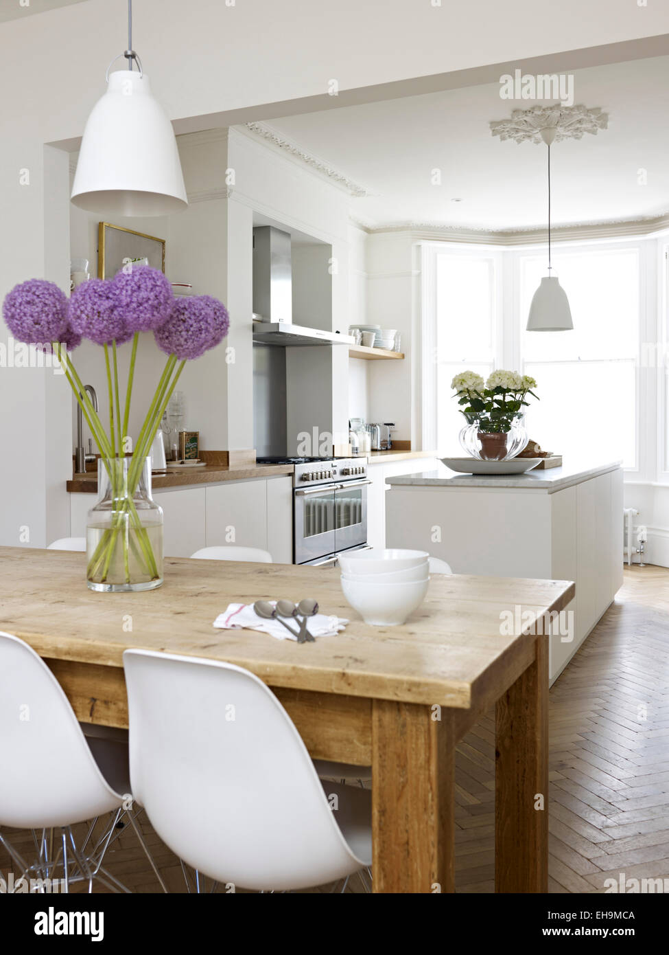White, open plan dining room and kitchen, residential house, Port ...