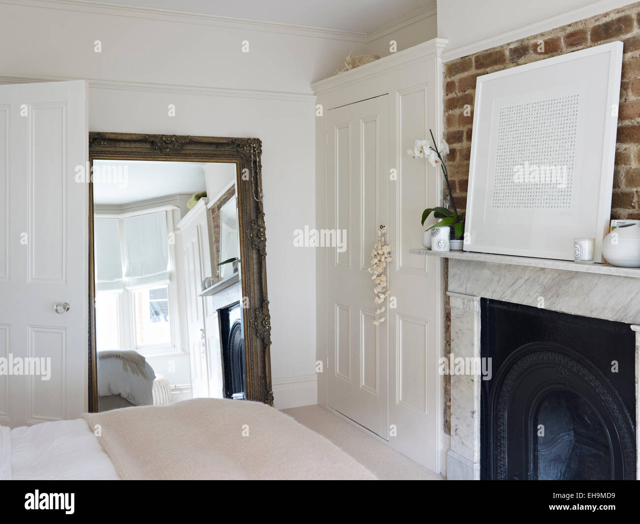 Bedroom with full length mirror, built-in panelled cupboard and ...
