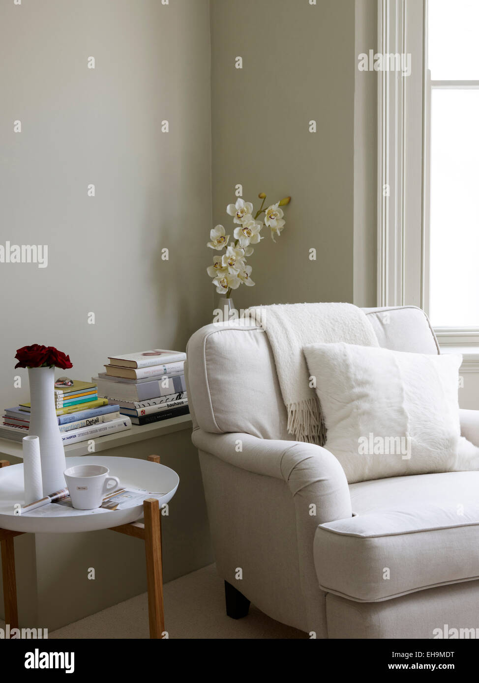 Coffee table and white comfy armchair, residential house, Port Hall Street, Brighton, East Sussex, UK - Stock Image