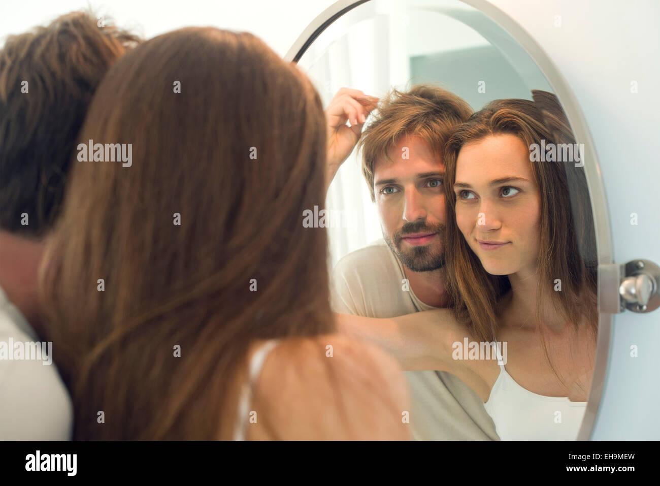Woman suggesting husband needs haircut - Stock Image