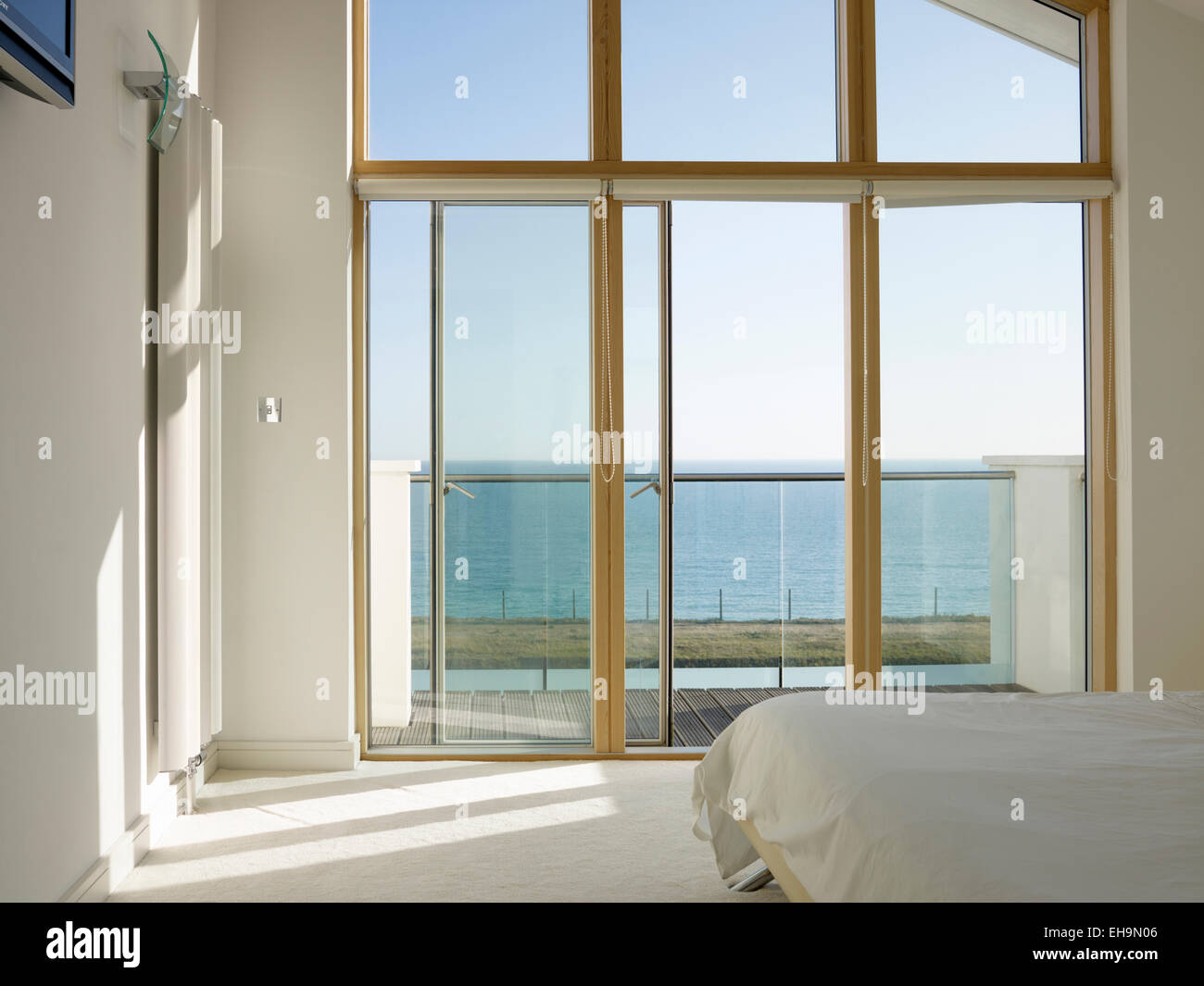 White Bedroom With Picture Window And Sliding Glass Door