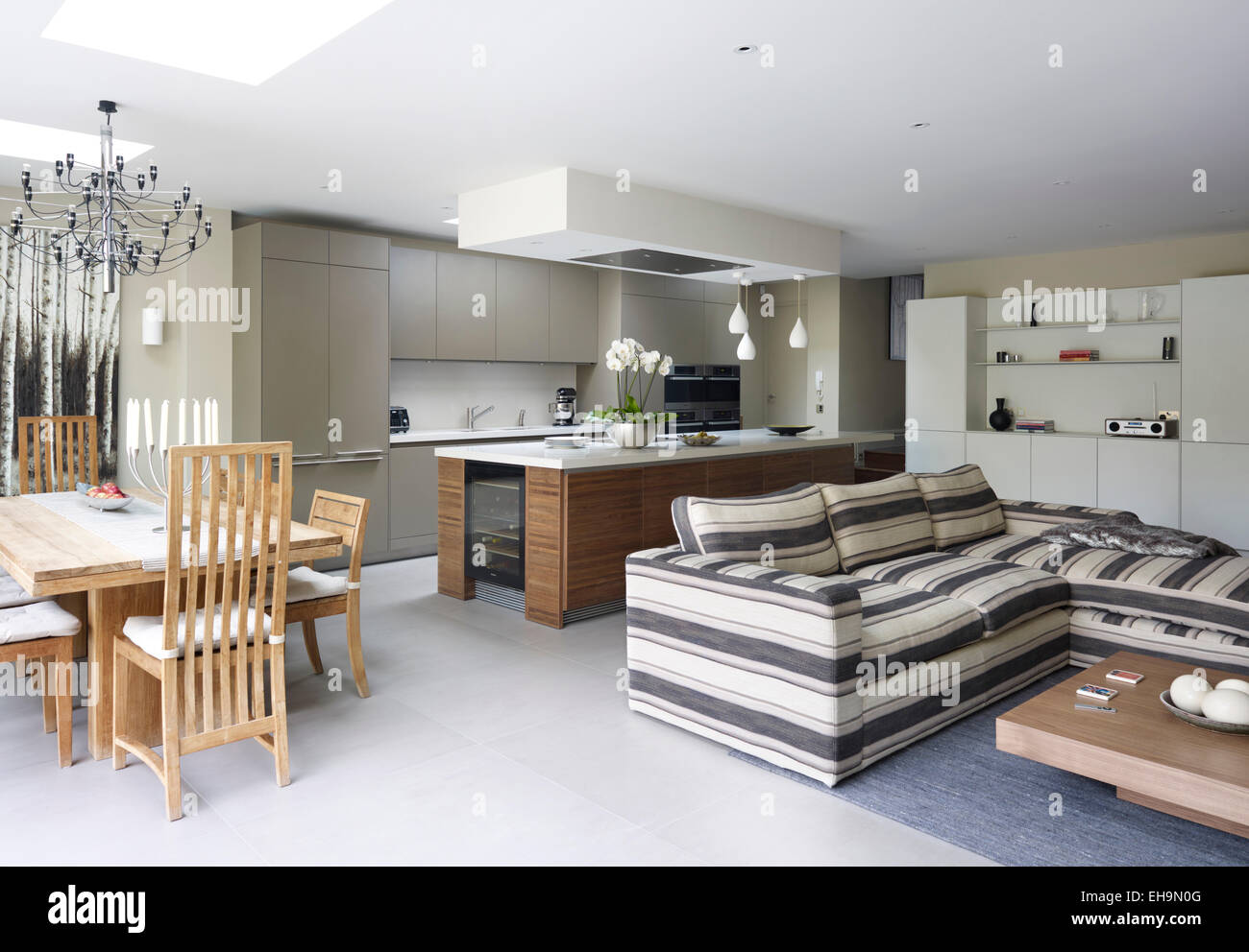 Modern open plan kitchen dining area and living area with striped corner sofa in Stevenage Road home UK & Modern open plan kitchen dining area and living area with striped ...