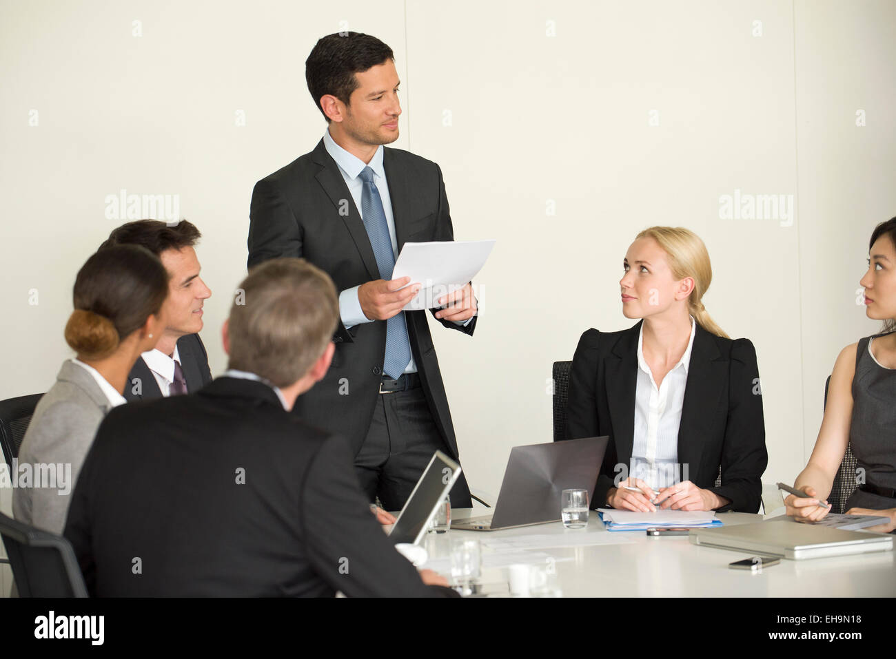 Executive giving presentation in meeting Stock Photo