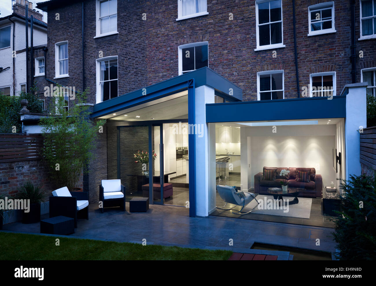 Exterior view of modern extension with glass walls in Walham Grove ...