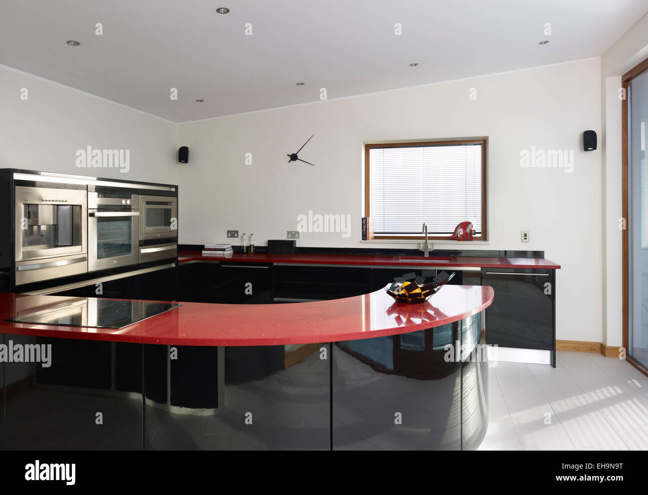 Black And Red Curved Kitchen Counter Top In Modern Kitchen Of Shirley Drive  Home, UK