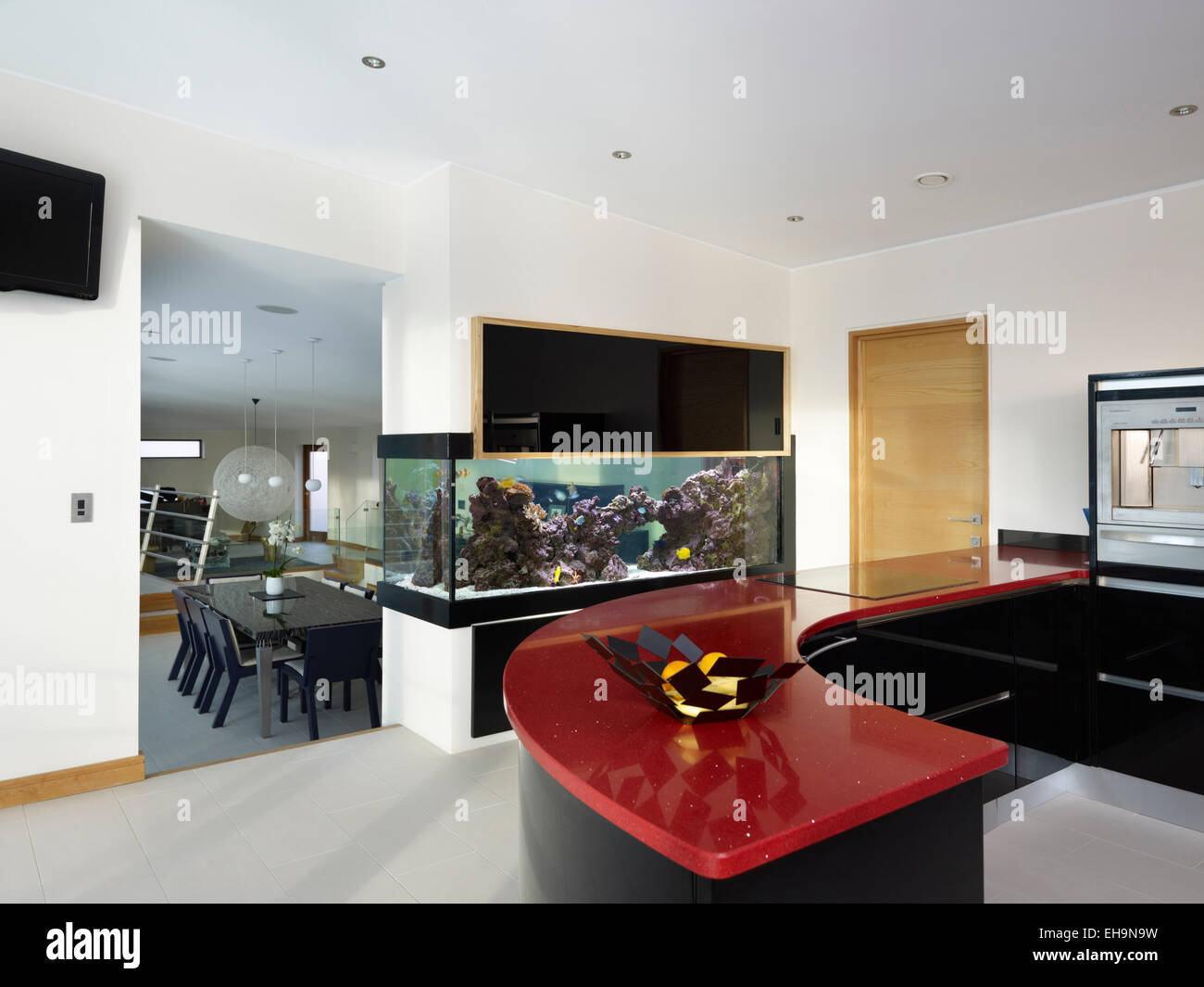 Black and red curved kitchen counter top in modern kitchen ...