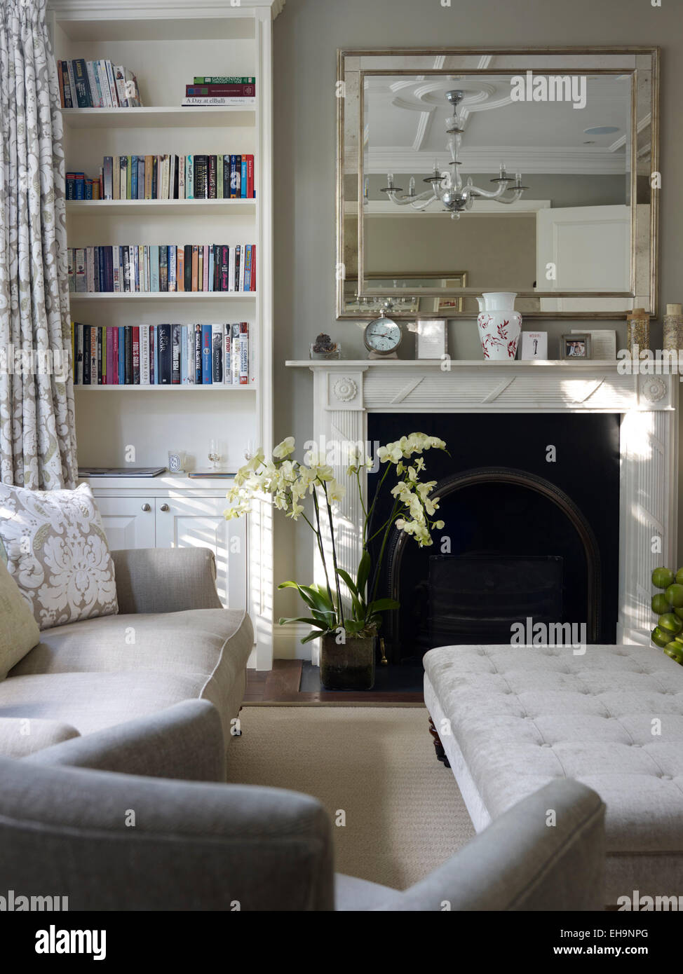 Fireplace And Mantel Piece With Mirror And Bookshelves In