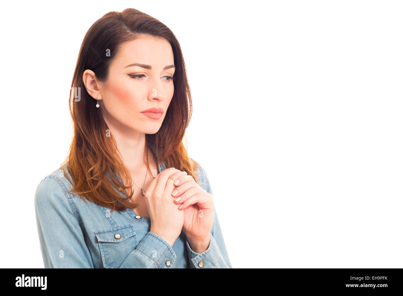 attractive lady contemplating about family issues touching ring - Stock Image