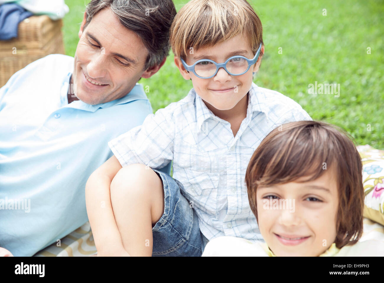 Boys spending time with father outdoors - Stock Image