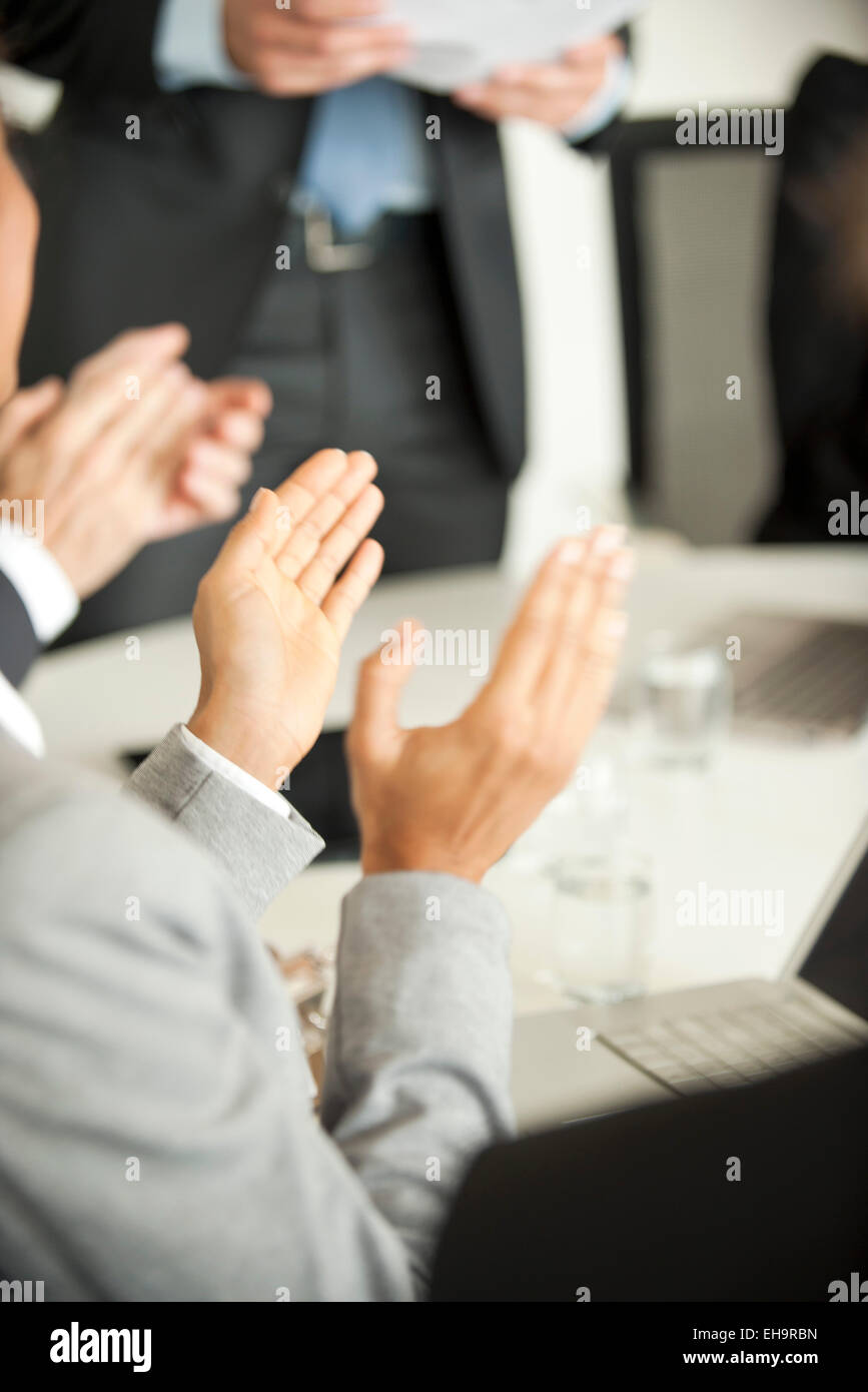 Businesspeople clapping at meeting - Stock Image