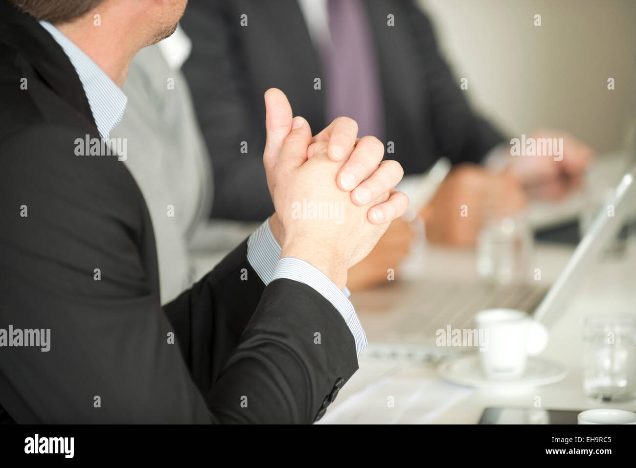 Businessman at meeting - Stock Image