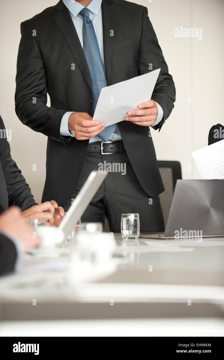 Businessman speaking at meeting - Stock Image