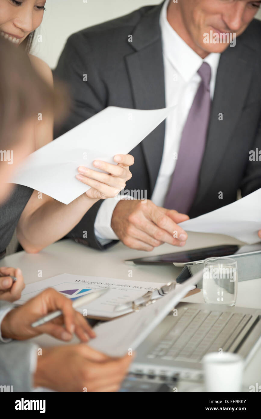 Businessman at meeting pleased by good news - Stock Image