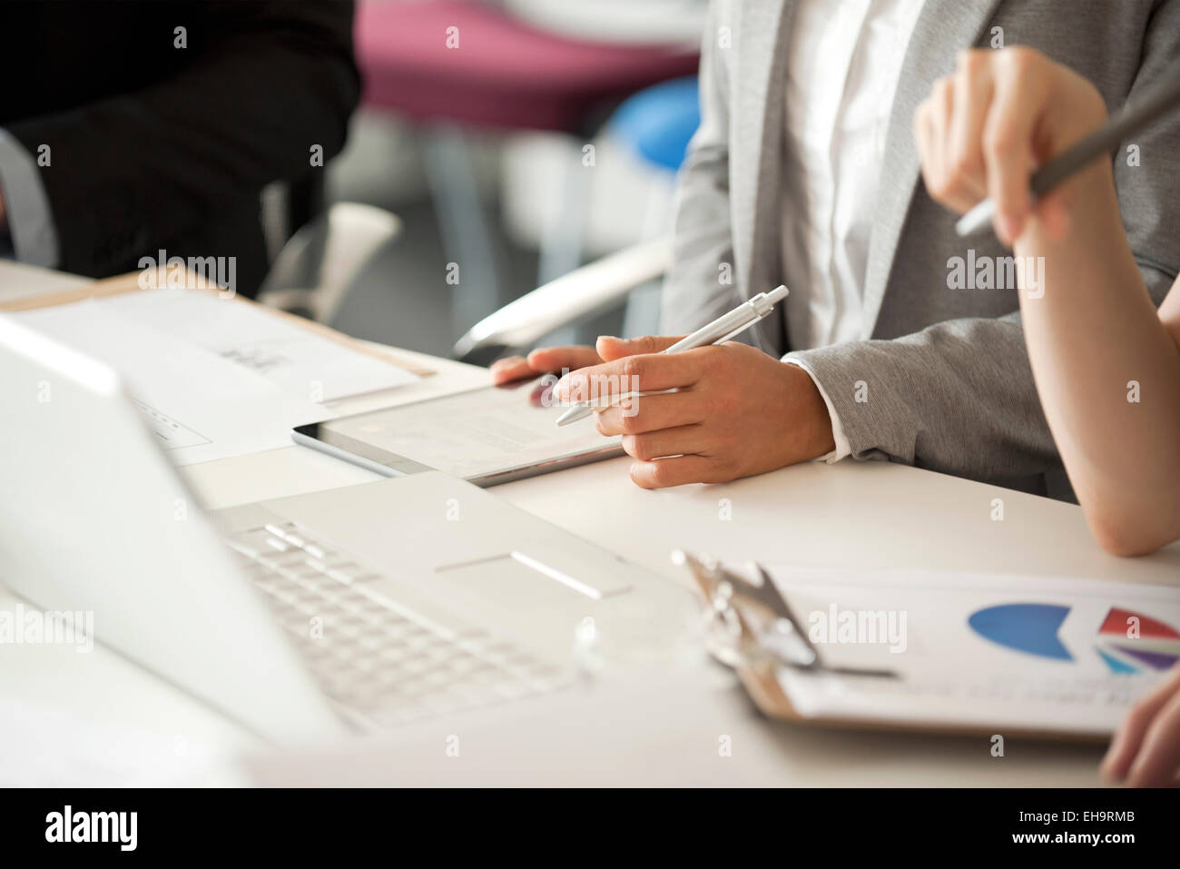 Business people collaborating, cropped - Stock Image