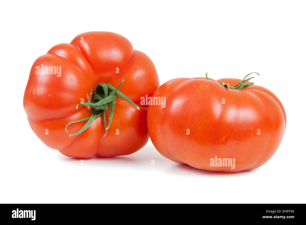 Fresh tomatoes isolated on white background with clipping path - Stock Image