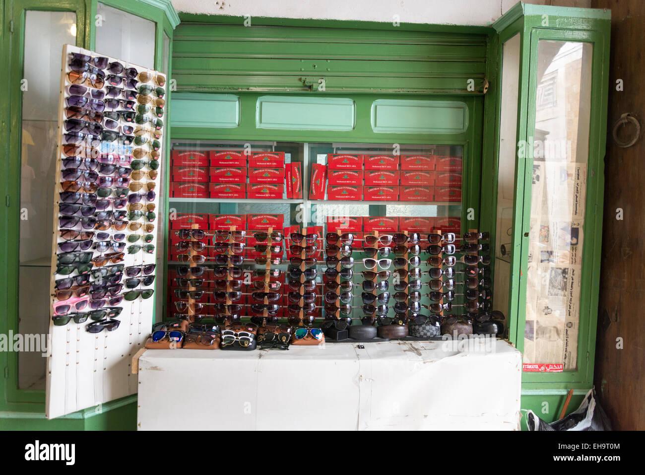 sunglass stall in medina, Tunisa - Stock Image