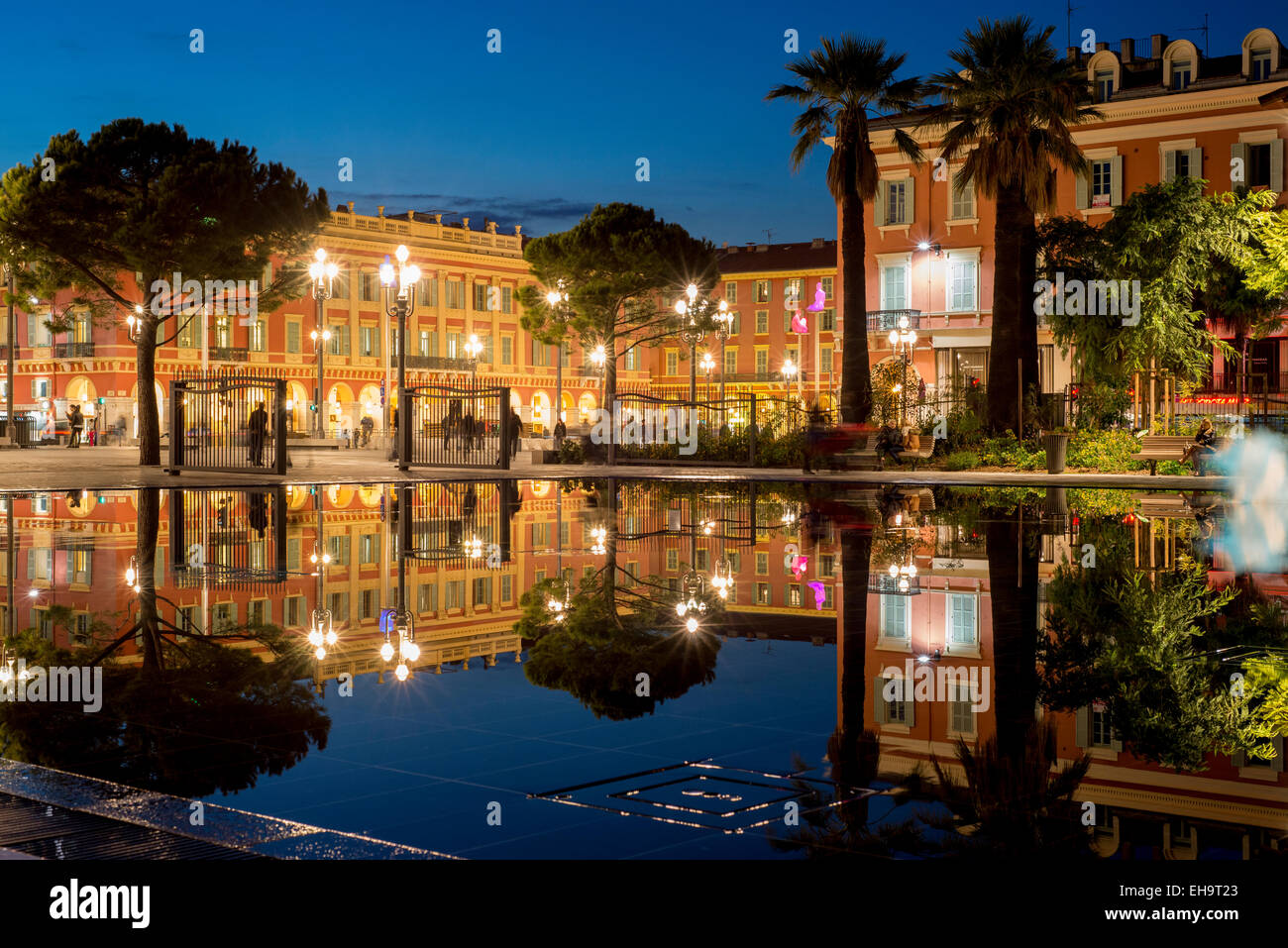 water area with fountains, mist and then calmness which creates reflections on the still water, Place Massena, Nice, - Stock Image