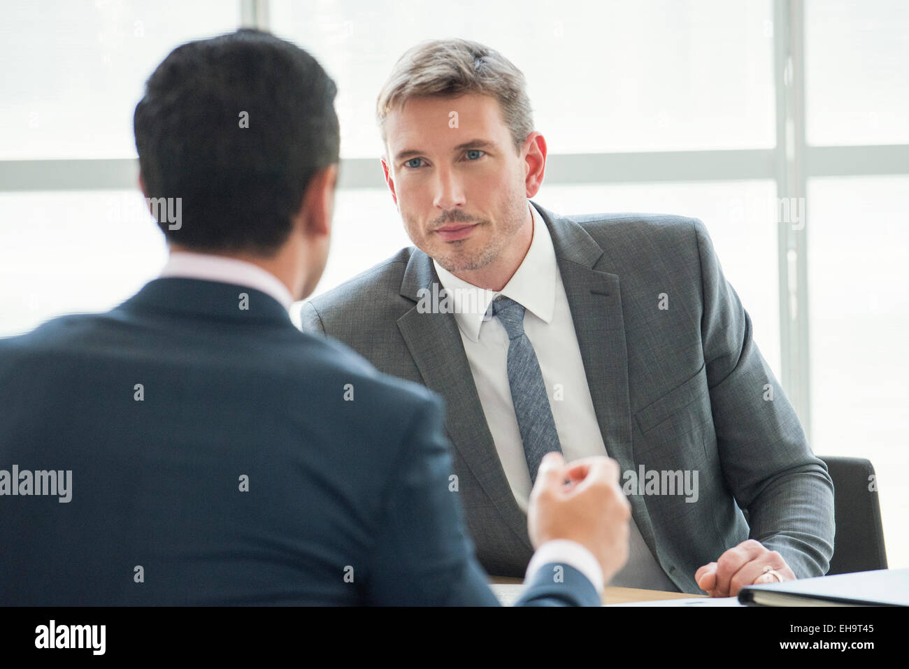 Businessmen in serious meeting - Stock Image