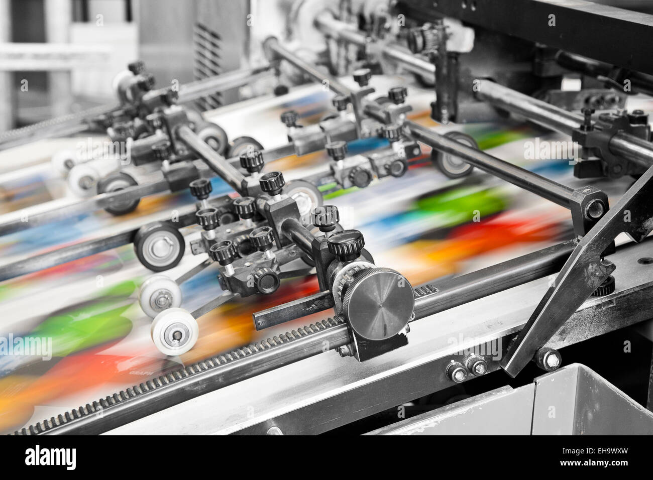 Close up of an offset printing machine during production - Stock Image