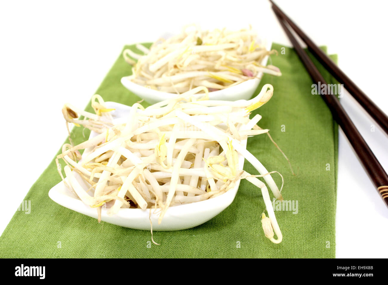 mung bean sprouts with chopsticks on a light background - Stock Image