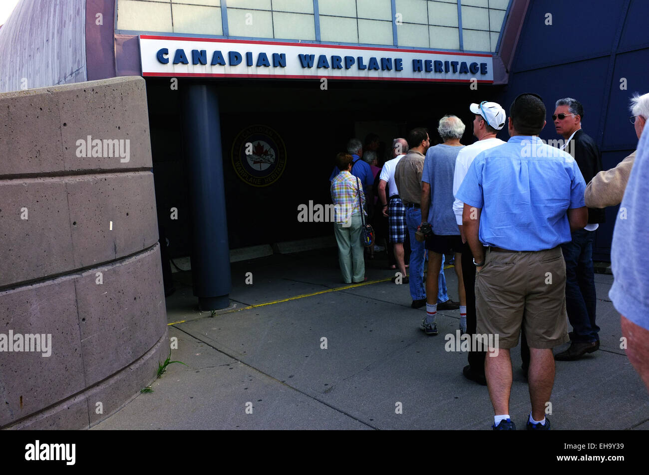 People wait to enter the Canadian Warplane Heritage Museum in Hamilton, Ontario in Canada. - Stock Image