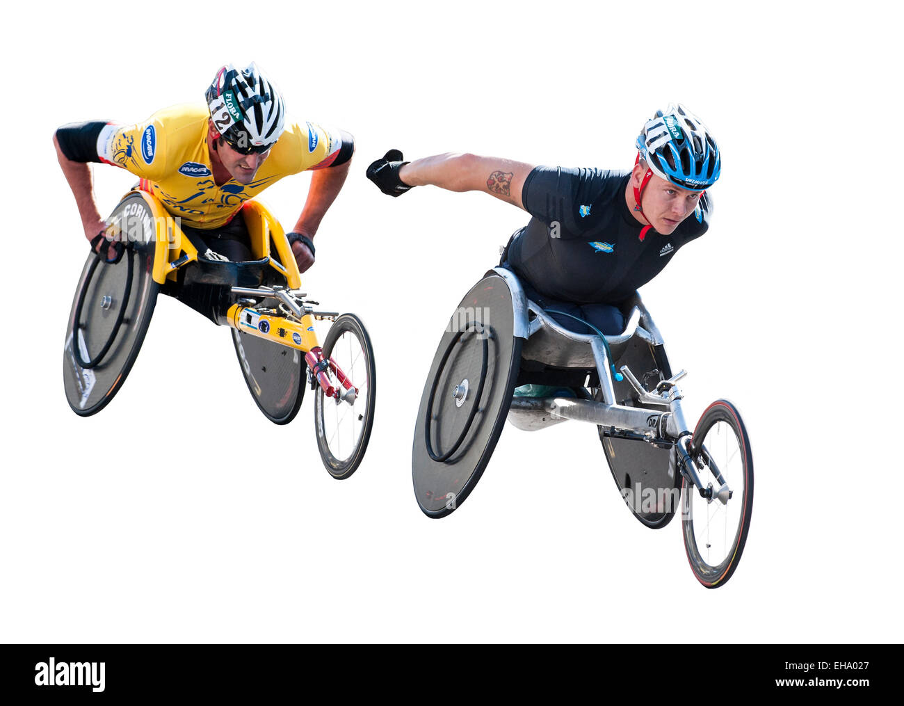 Disabled athletes taking part in the London marathon wheelchair race on a white background - Stock Image