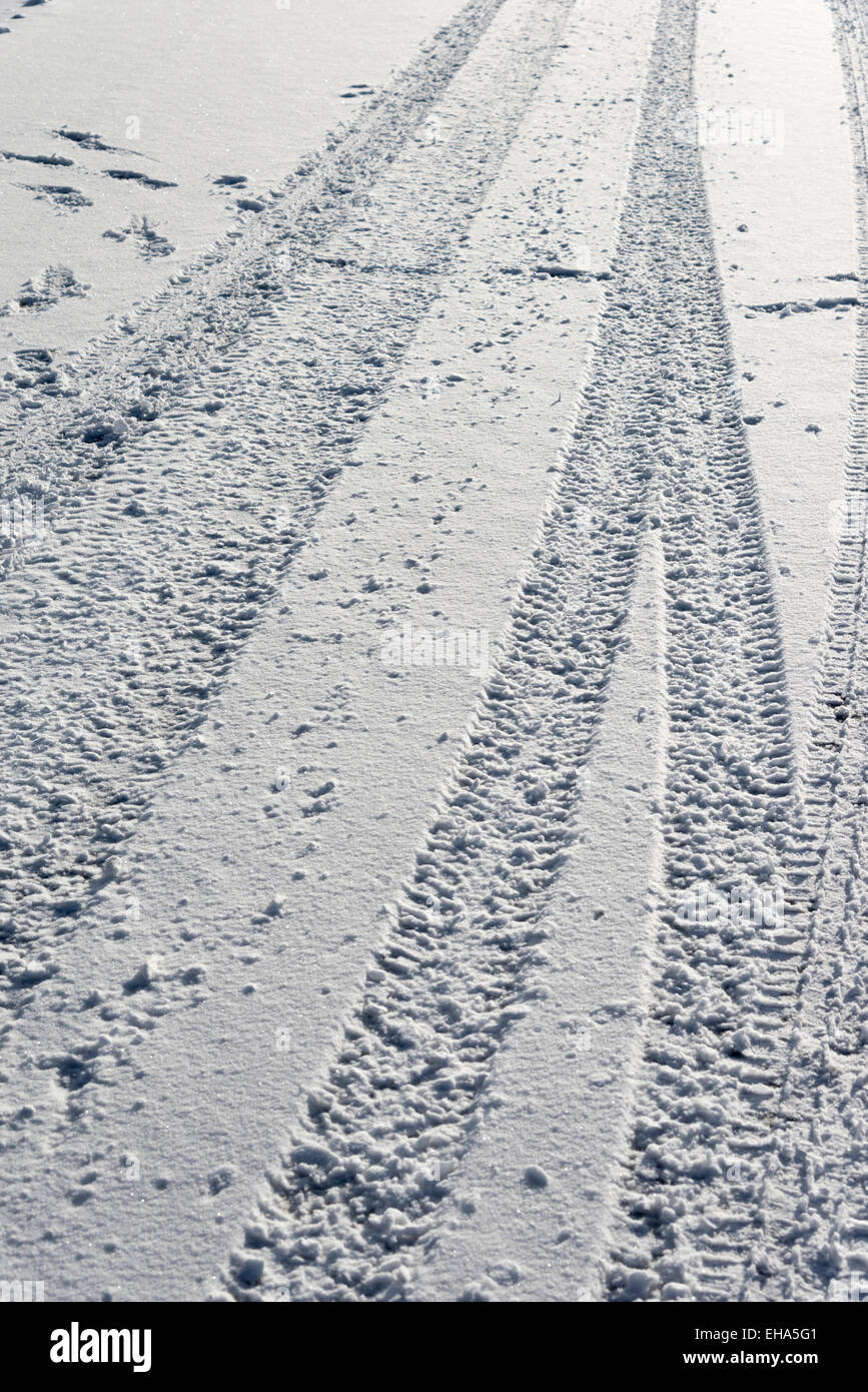 Tyre tracks in the snow.  Winter driving. - Stock Image