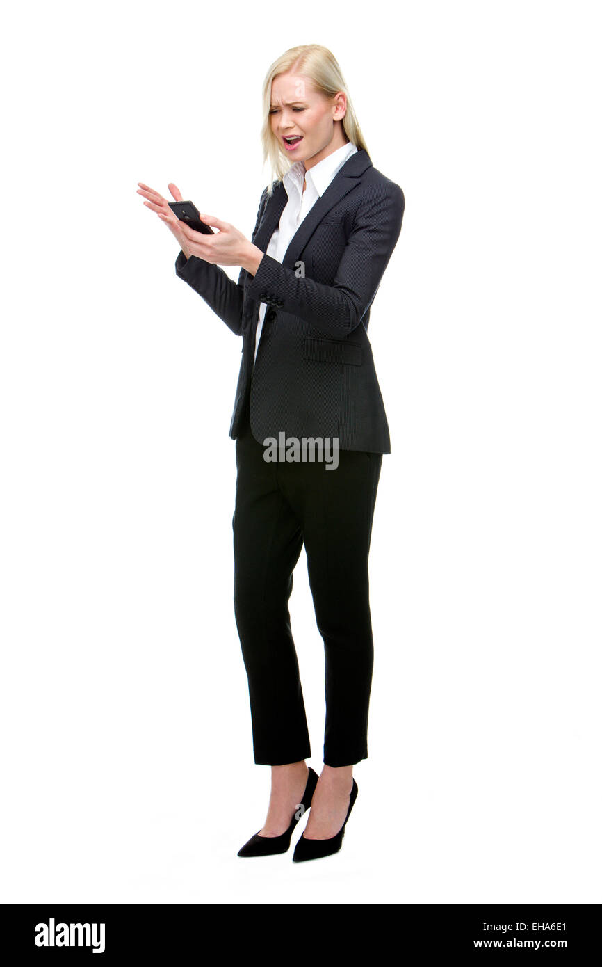 angry businesswoman shouting at mobile phone - Stock Image