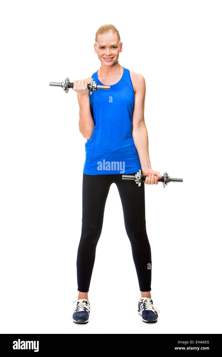 woman wearing fitness clothing exercising with weights - Stock Image