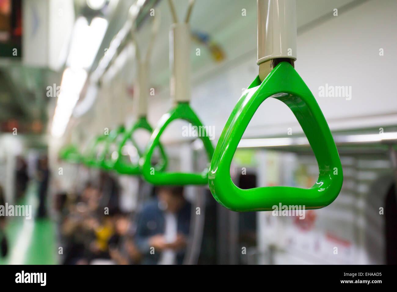 A handle for passengers in a Seoul subway train carriage - Stock Image