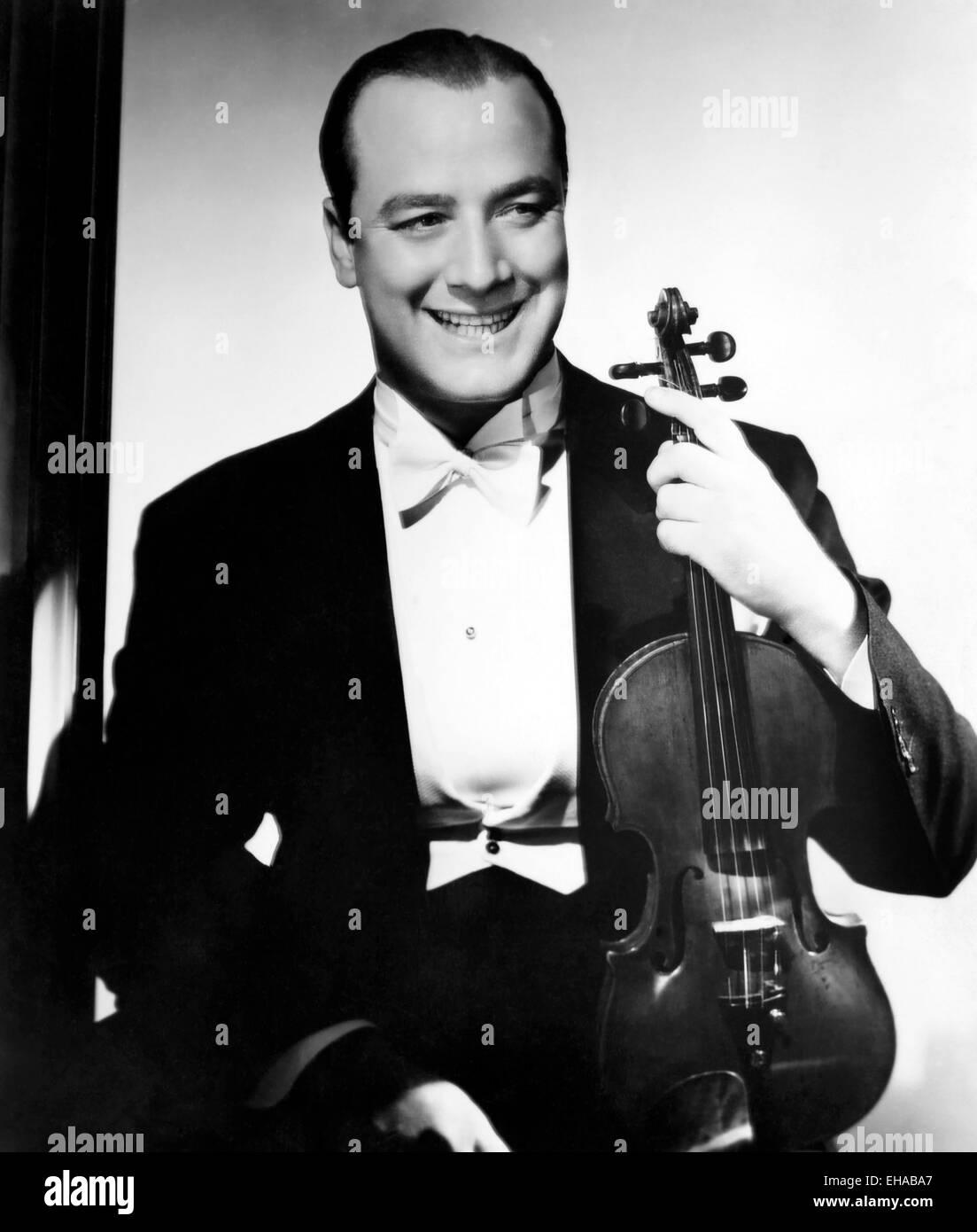 Joe Venuti, Smiling Portrait with Violin, circa 1940 - Stock Image
