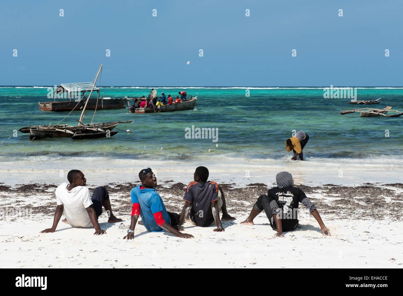 Zanzibar, Matemwe, Fishermen On Sea Shore - Stock Image