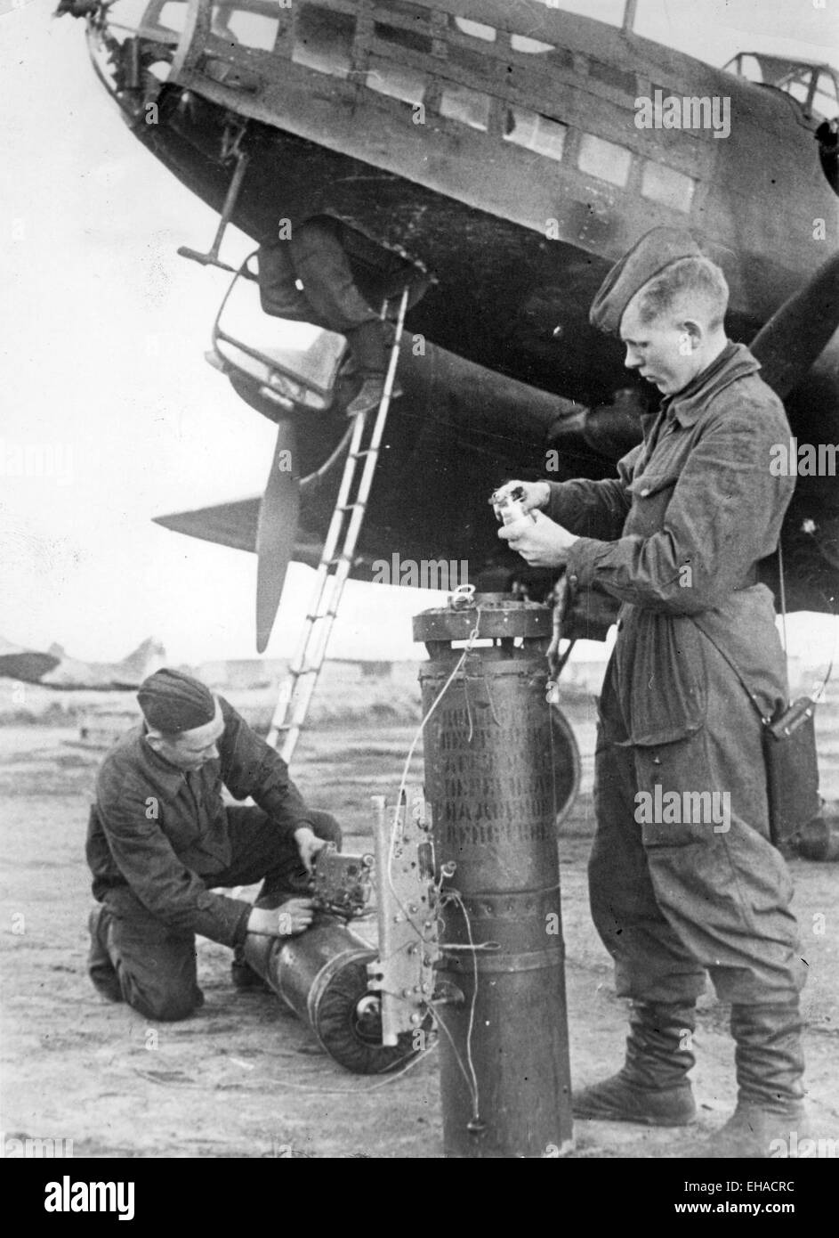 ILYUSHIN Il-4  Soviet WW2 bomber. Ground crew preparing flares for use in night bombing raids  about 1943. Note - Stock Image