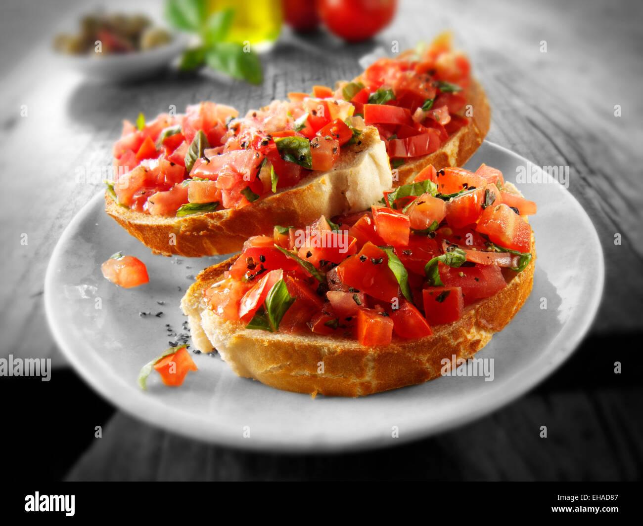 Fresh chopped beefsteak tomato bruschettas - Stock Image