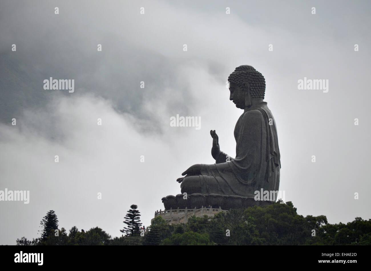 Tian Tan Buddha, also known as Big Buddha, is a gigantic bronze statue on Lantau Island in Hong Kong. - Stock Image