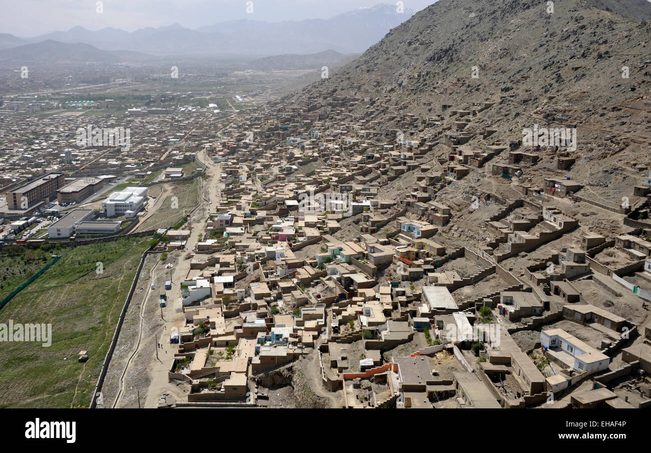 Kabul in Afghanistan from the air, show green areas, built up areas, housing, roads and the mountainous regions - Stock Image