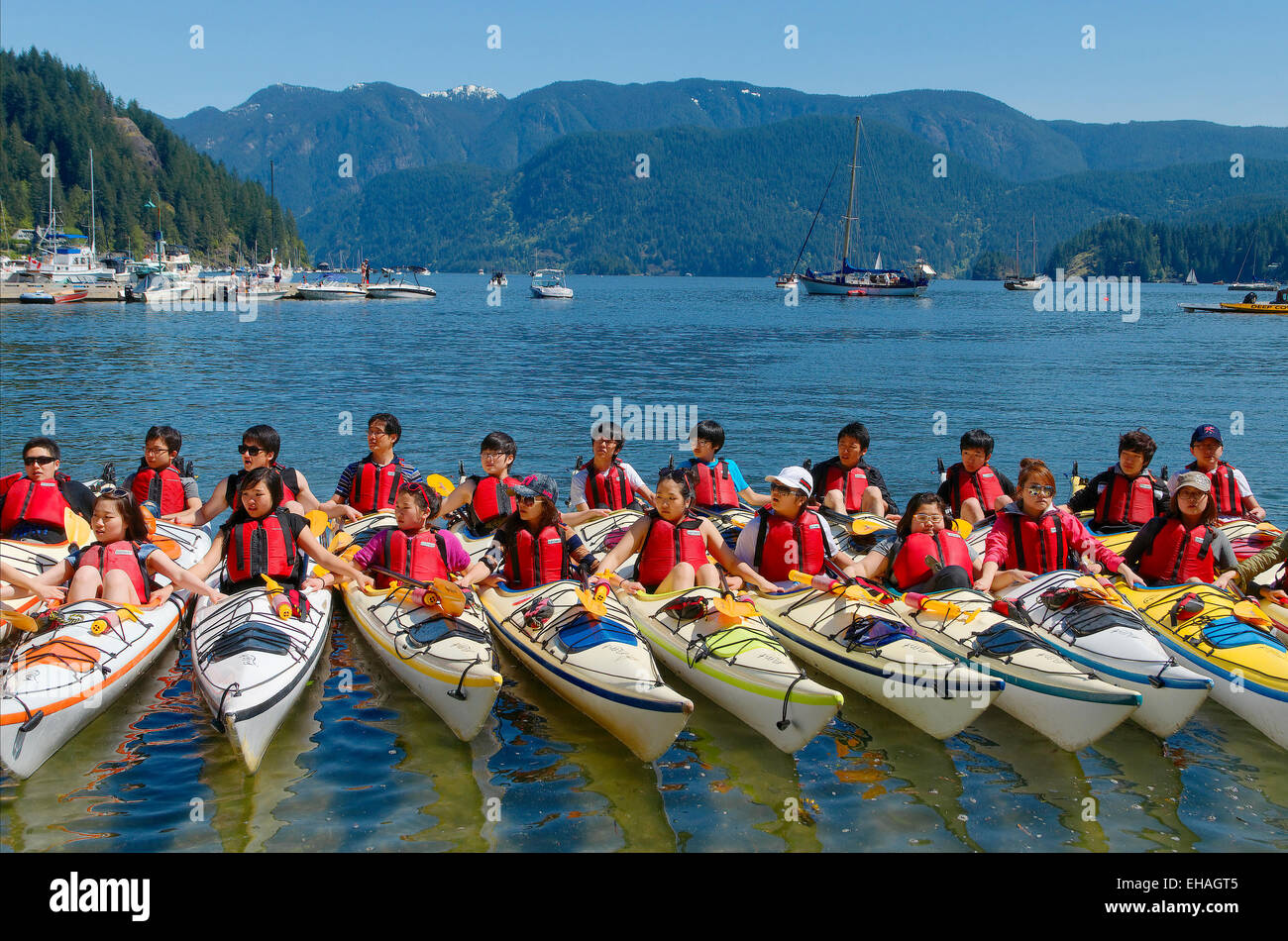 Teen novice kayakers get training , Deep Cove, District of North Vancouver, British Columbia, Canada - Stock Image