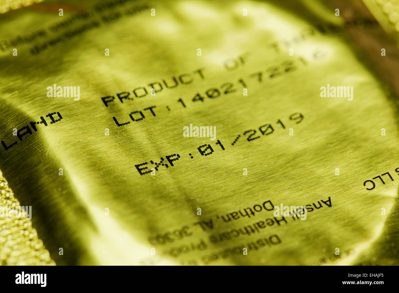 Expiration date on condom package - USA - Stock Image