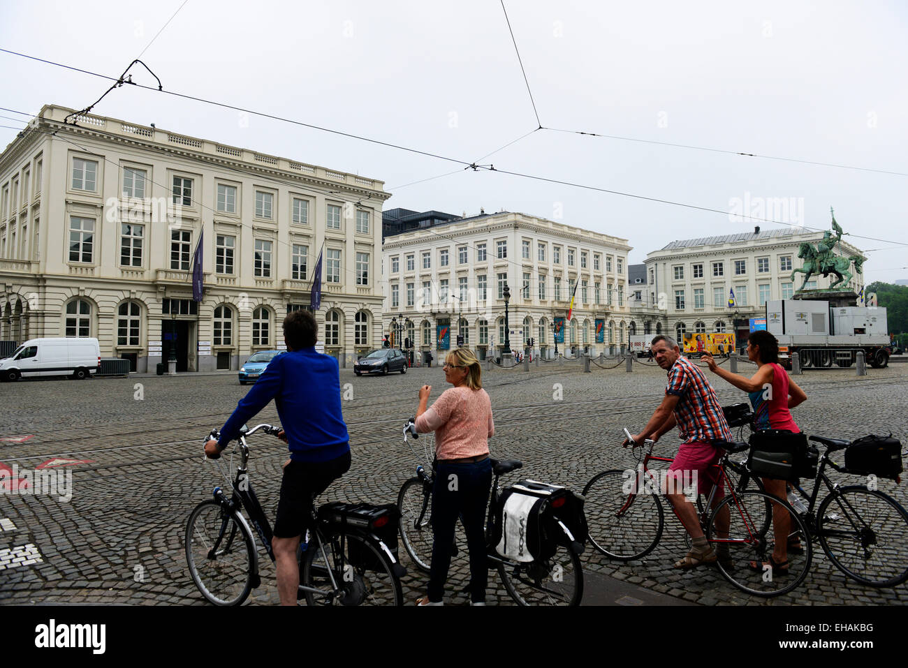 Cycling through Place Royale ( Royal square ) in Brussels. - Stock Image