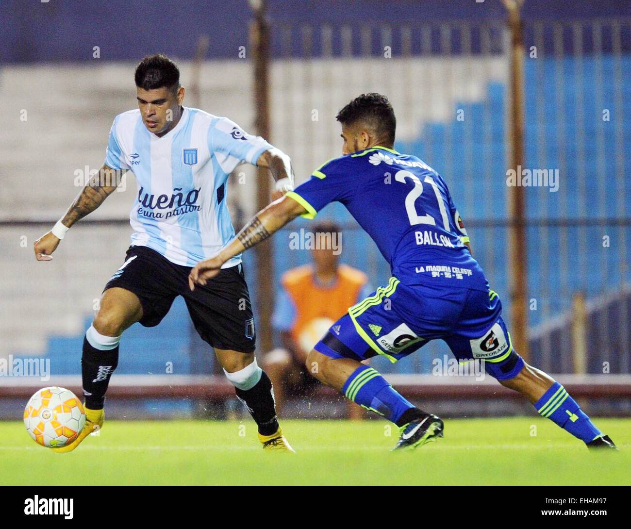 Buenos Aires, Argentina. 10th Mar, 2015. Racing Club's Gustavo Bou (L) of Argentina vies for the ball with Sporting - Stock Image