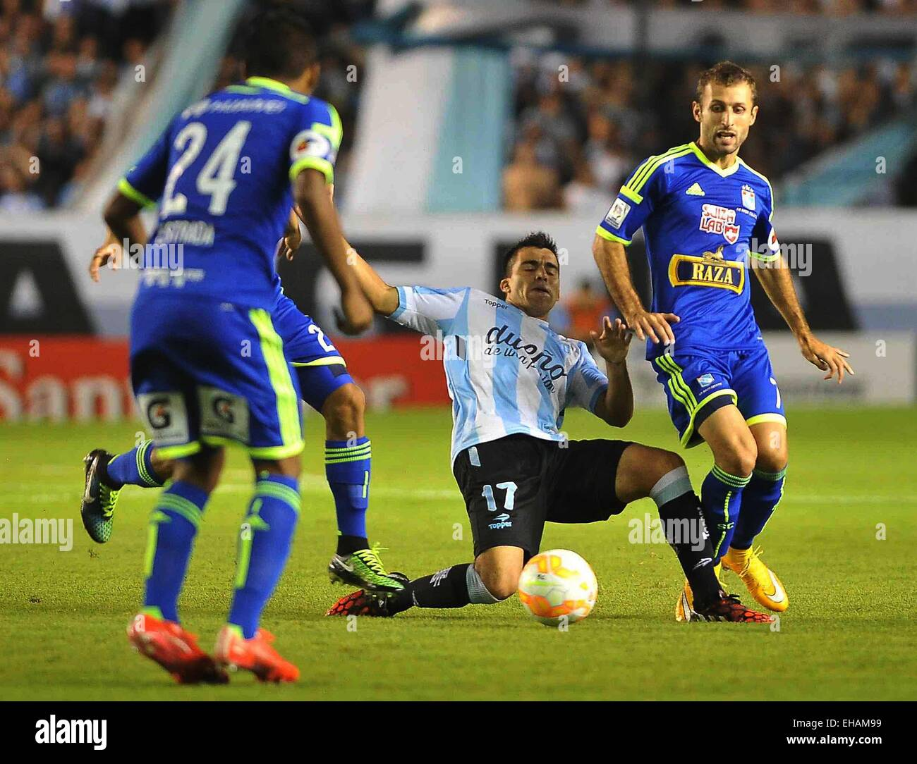 Buenos Aires, Argentina. 10th Mar, 2015. Racing Club's Marcos Acuna (C) of Argentina vies for the ball with - Stock Image