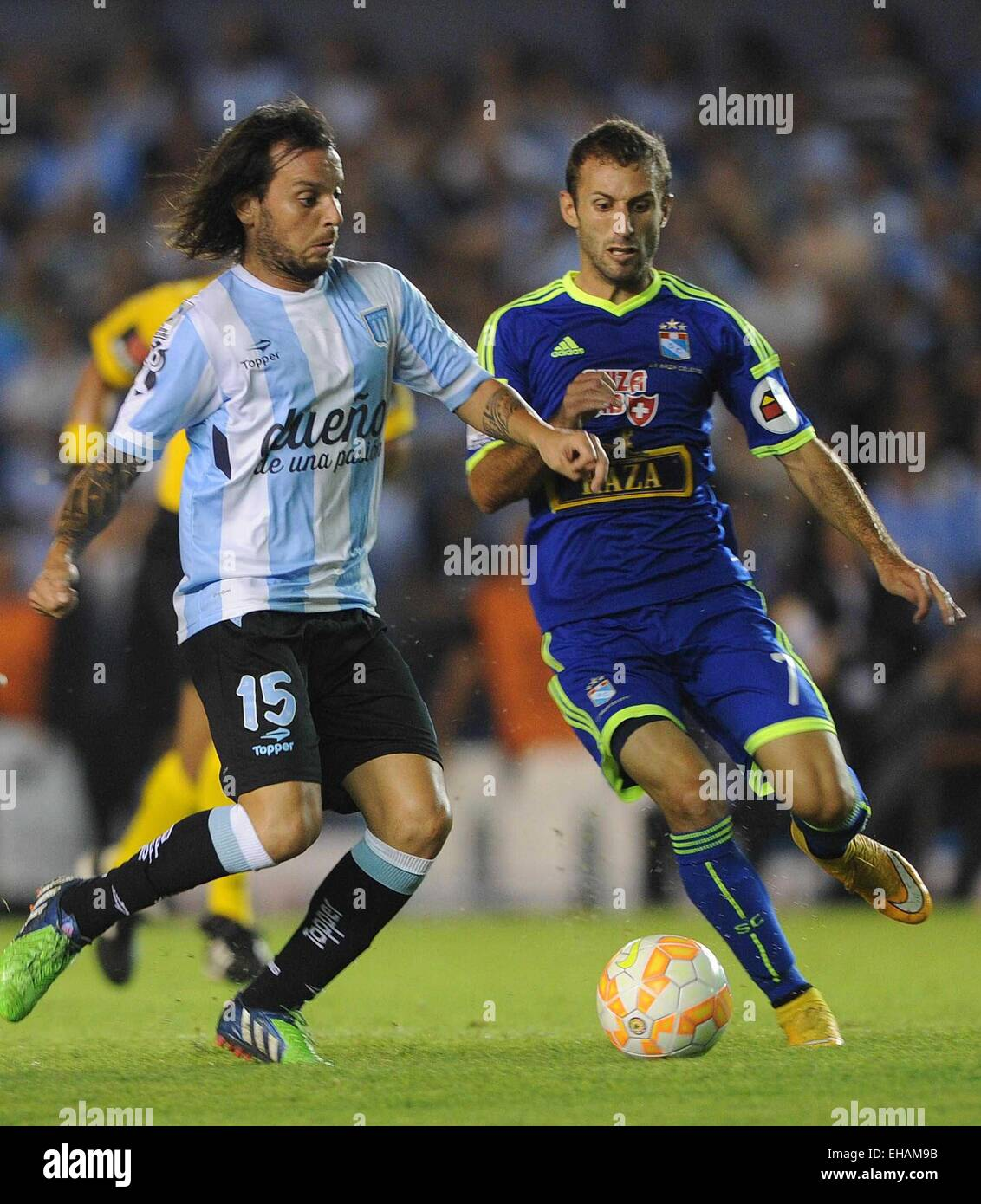 Buenos Aires, Argentina. 10th Mar, 2015. Racing Club's Ezequiel Videla (L) of Argentina vies for the ball with - Stock Image