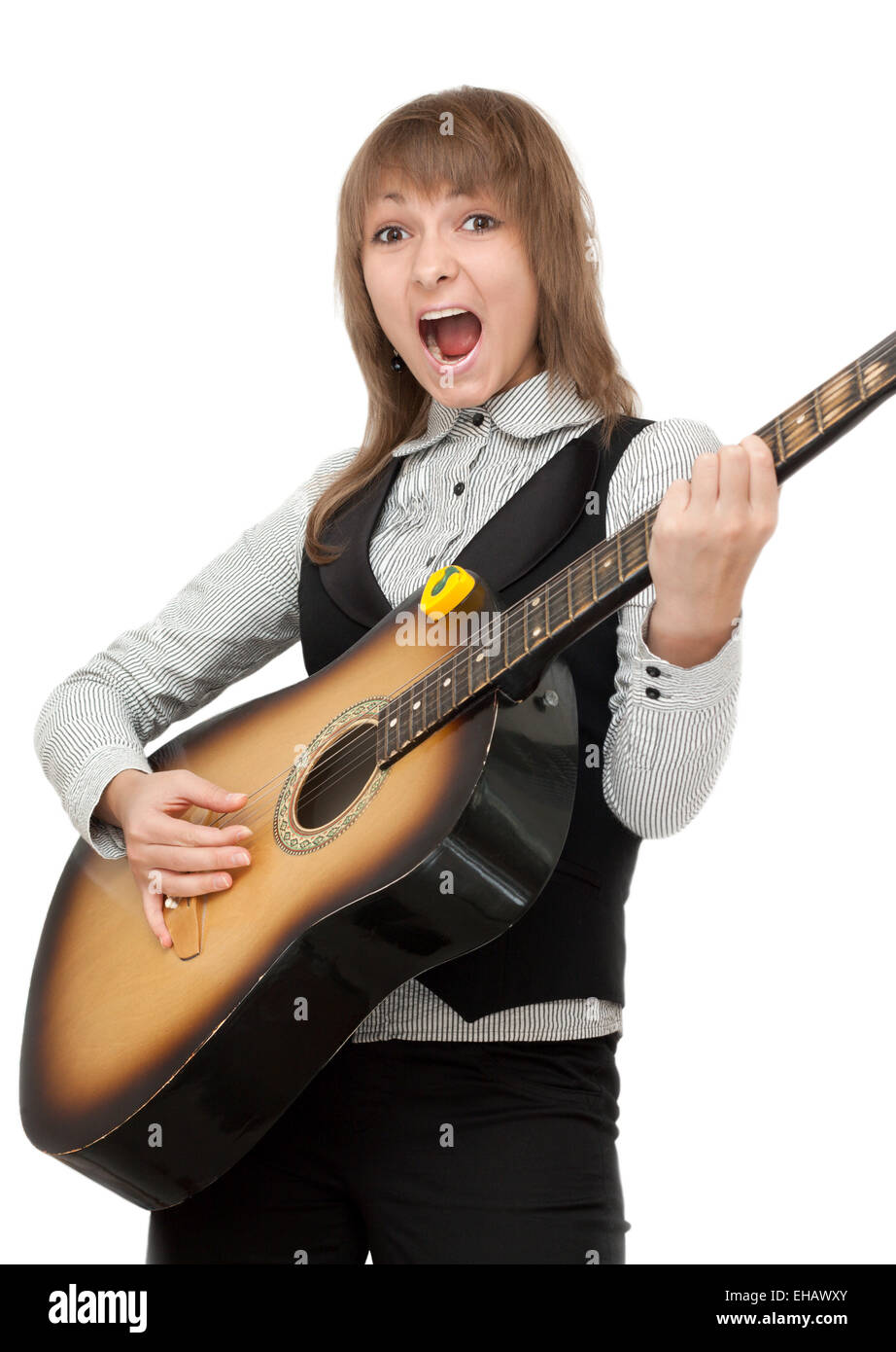 Girl with guitar in hand expressive sings - Stock Image