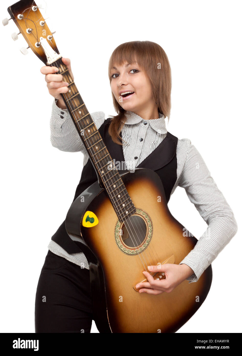 Young girl with guitar sings - Stock Image