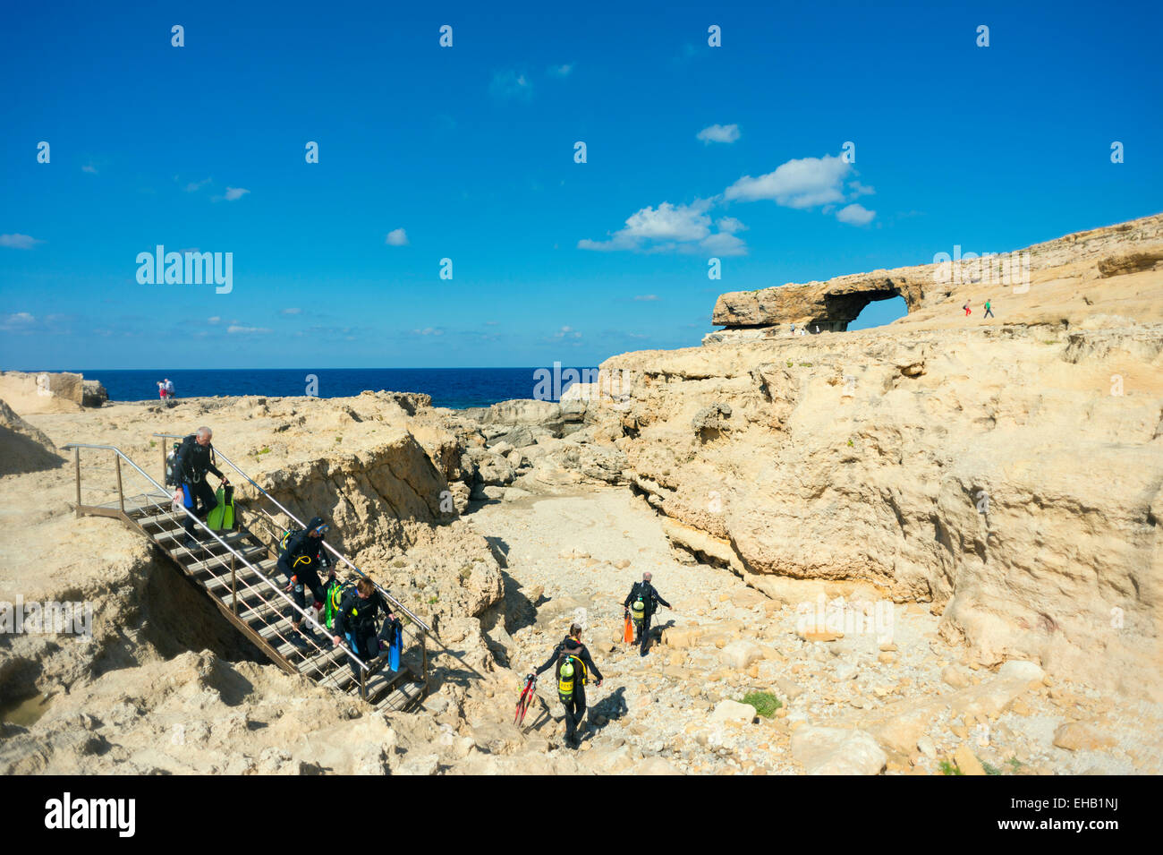 Mediterranean Europe, Malta, Gozo Island, Dwerja Bay, The Azure Window natural arch, scuba divers at the Blue Hole - Stock Image
