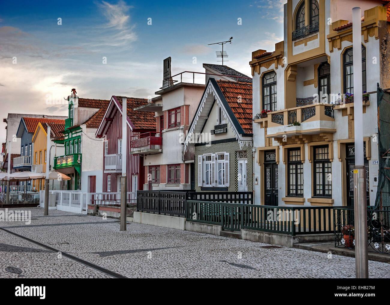 Costa Nova do Prado ( Portugal) famous home Palheiros with their houses with colorful stripes derived from original Stock Photo